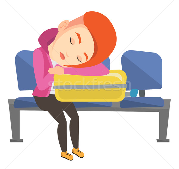 Exhausted woman sleeping on suitcase at airport. Stock photo © RAStudio