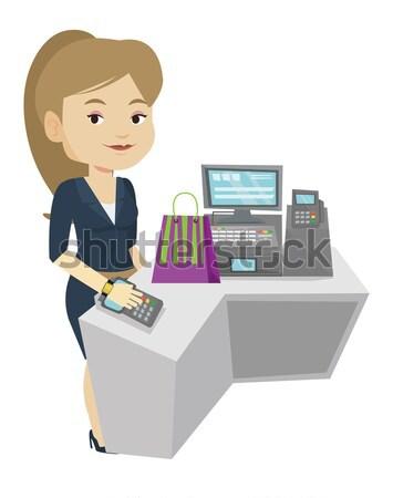 Woman paying wireless with smart watch. Stock photo © RAStudio