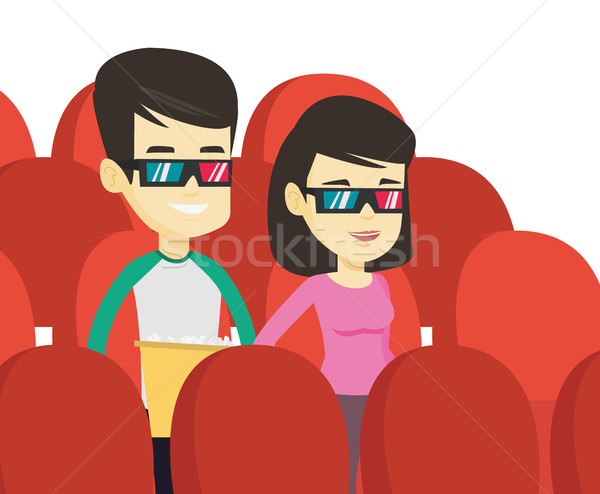Happy friends watching 3D movie in the theatre. Stock photo © RAStudio