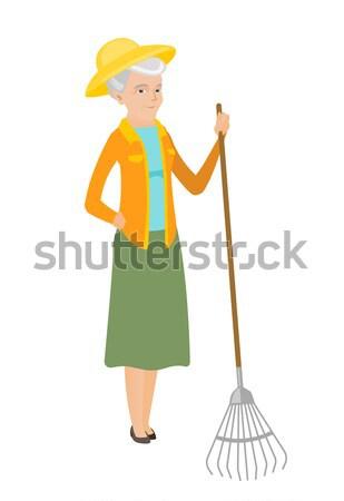 Cleaner holding bucket full of cleaning equipment. Stock photo © RAStudio
