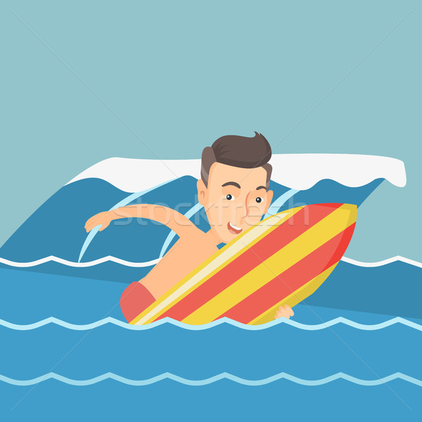 Happy surfer in action on a surfboard. Stock photo © RAStudio