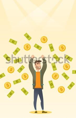 Young caucasian busiessman under money rain. Stock photo © RAStudio