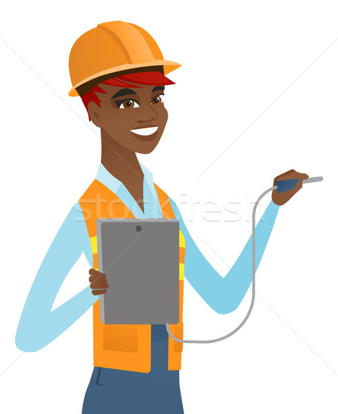 African electrician with electrical equipment. Stock photo © RAStudio