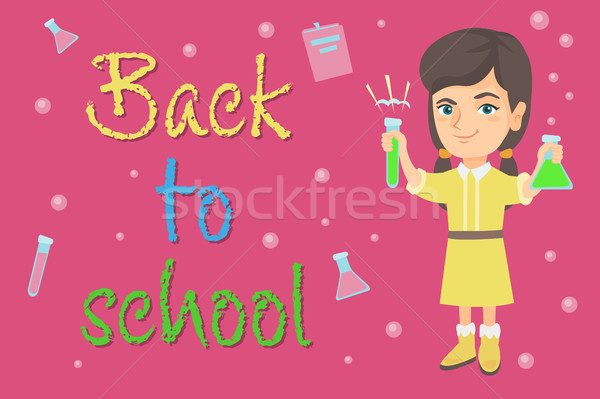 Caucasian schoolgirl holding test tube and beaker. Stock photo © RAStudio