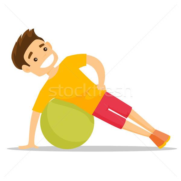 Young caucasian white man exercising with fitball. Stock photo © RAStudio