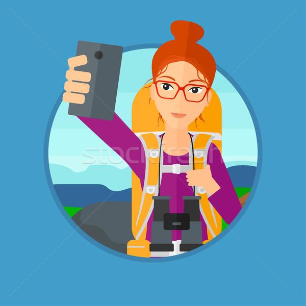 Woman with backpack making selfie. Stock photo © RAStudio