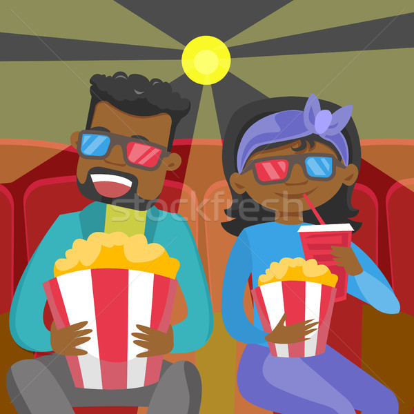 Young african friends in 3d glasses watching movie Stock photo © RAStudio