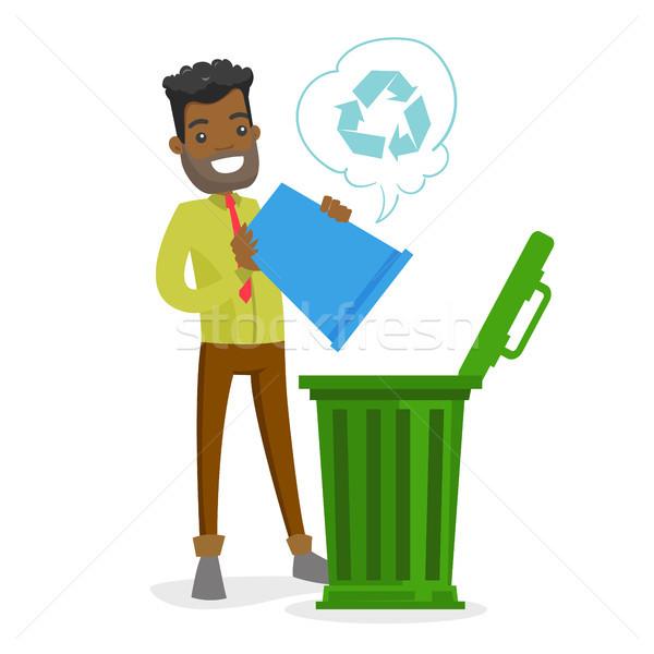 молодые африканских человека Recycle мусорное ведро Сток-фото © RAStudio