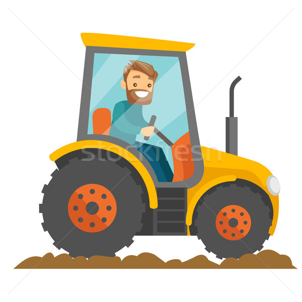 A white happy farmer in tractor on a rural farm field. Stock photo © RAStudio