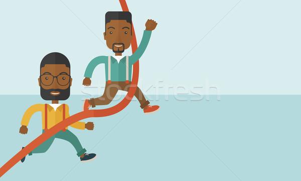 Two african guy running to finish line. Stock photo © RAStudio