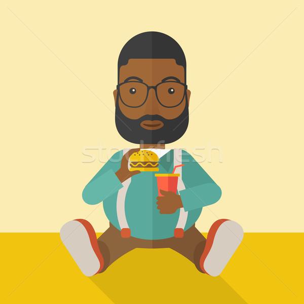 Uomo mangiare hamburger uomo grasso barba seduta Foto d'archivio © RAStudio