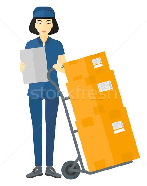 Woman delivering boxes. Stock photo © RAStudio