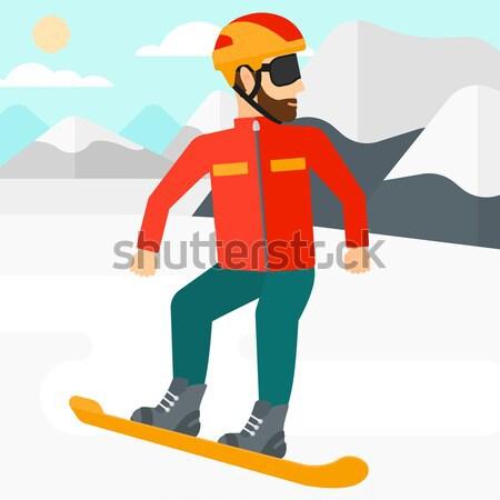 Young man snowboarding. Stock photo © RAStudio