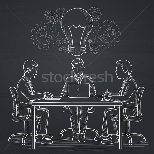 Zespół firmy burza mózgów ludzi biznesu posiedzenia tabeli pomysł Zdjęcia stock © RAStudio