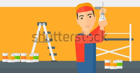 Electrician twisting light bulb. Stock photo © RAStudio