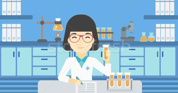 Laboratórium asszisztens dolgozik ázsiai női elvesz Stock fotó © RAStudio