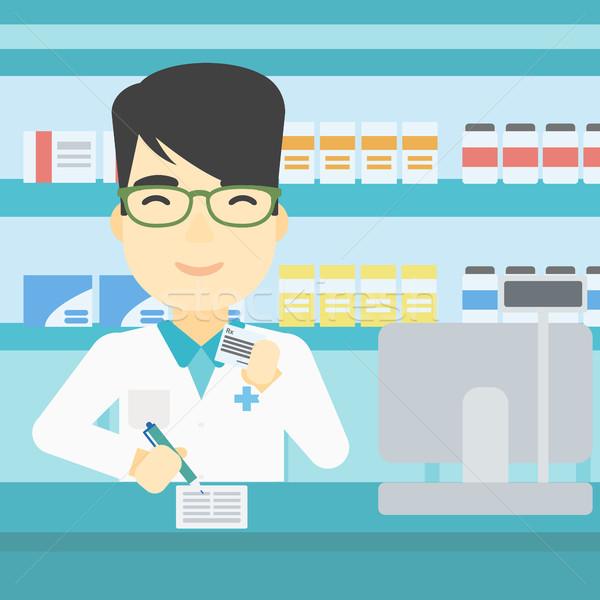 Farmacéutico escrito prescripción Asia jóvenes masculina Foto stock © RAStudio