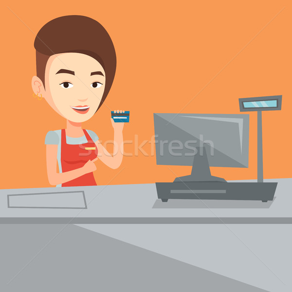 Cashier holding credit card at the checkout. Stock photo © RAStudio
