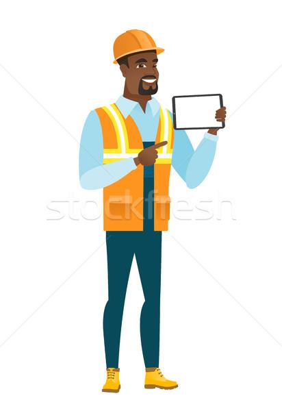 African-american builder holding tablet computer. Stock photo © RAStudio