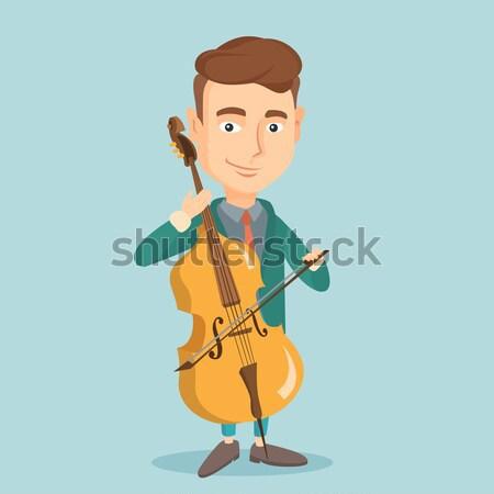 Homem jogar violoncelo jovem feliz asiático Foto stock © RAStudio
