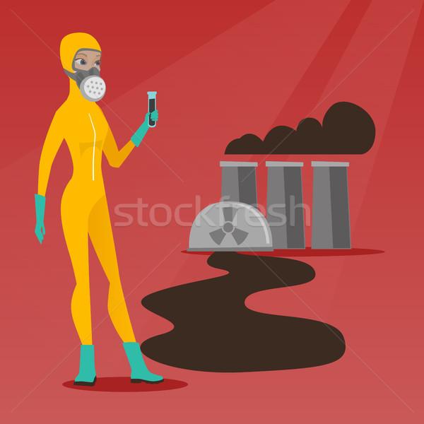 Donna radiazione suit provetta piedi nucleare Foto d'archivio © RAStudio
