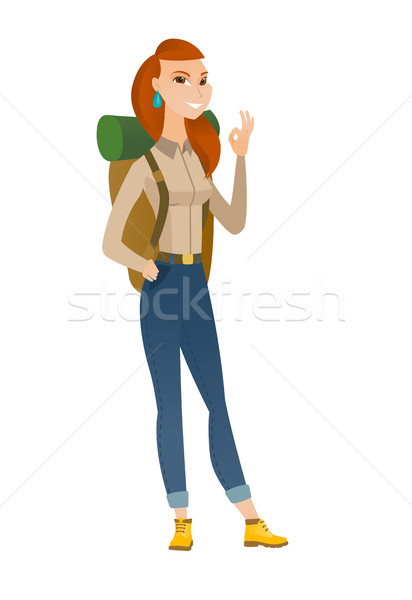 Smiling traveler showing ok sign. Stock photo © RAStudio