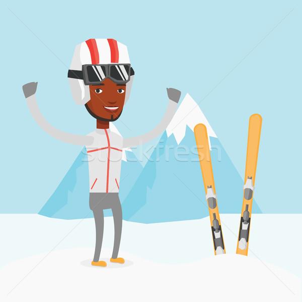 Vrolijk skiër permanente opgeheven handen bergen jonge Stockfoto © RAStudio