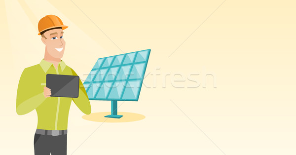 Caucasian worker of solar power plant. Stock photo © RAStudio