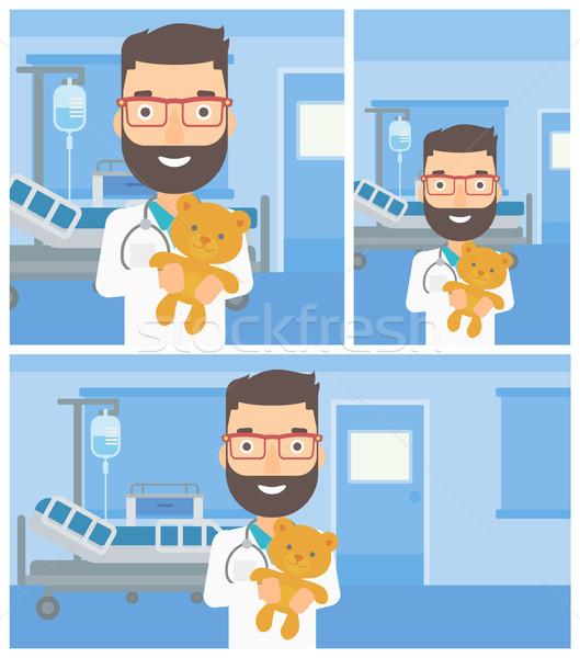Pediatrician doctor holding teddy bear. Stock photo © RAStudio