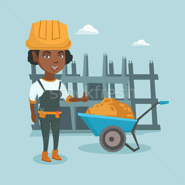 Young african-american builder giving thumb up. Stock photo © RAStudio