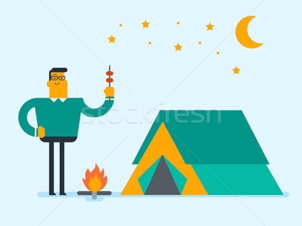 Homem sessão fogueira camping jovem caucasiano Foto stock © RAStudio