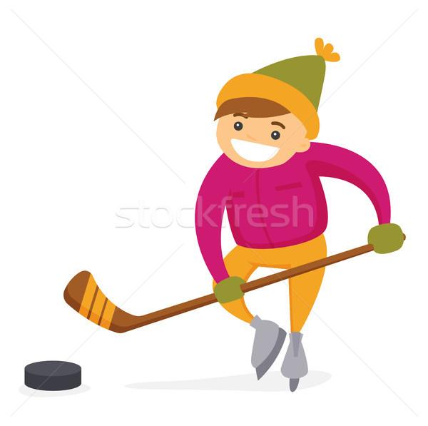 Kaukázusi fiú játszik jégkorong szabadtér pálya Stock fotó © RAStudio