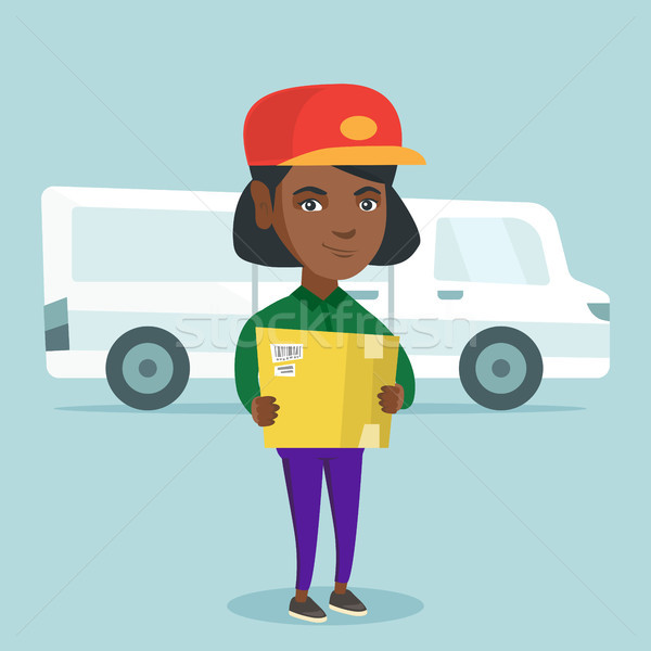 African-american delivery courier holding a box. Stock photo © RAStudio