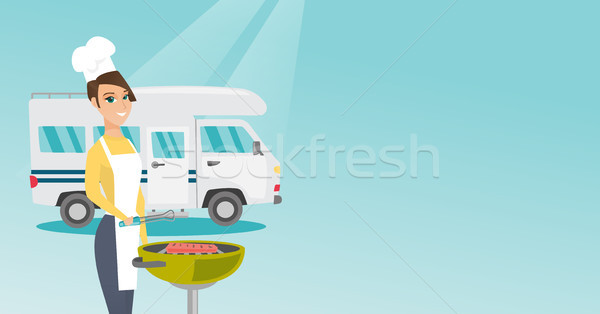 Woman barbecuing meat in front of camper van. Stock photo © RAStudio