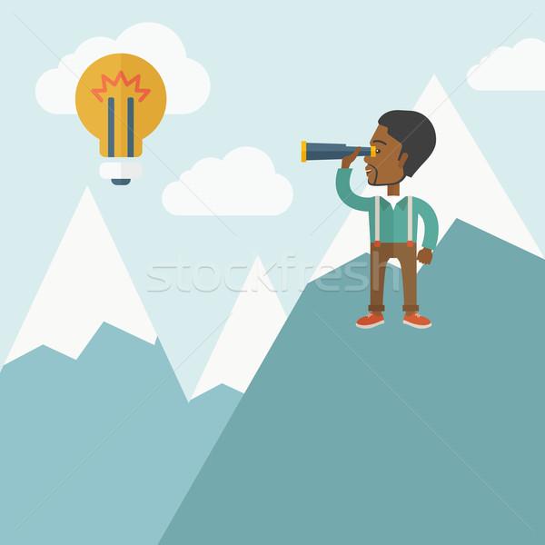 Black man on top of blue mountain. Stock photo © RAStudio