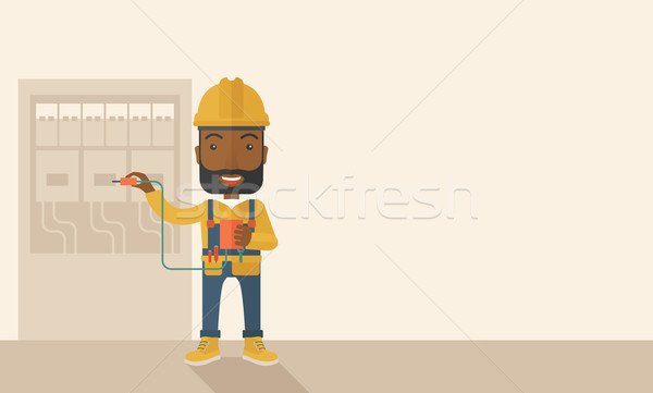 Black electrician repairing an electrical panel Stock photo © RAStudio