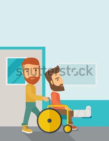 Homme poussant fauteuil roulant jambe cassée patient Photo stock © RAStudio