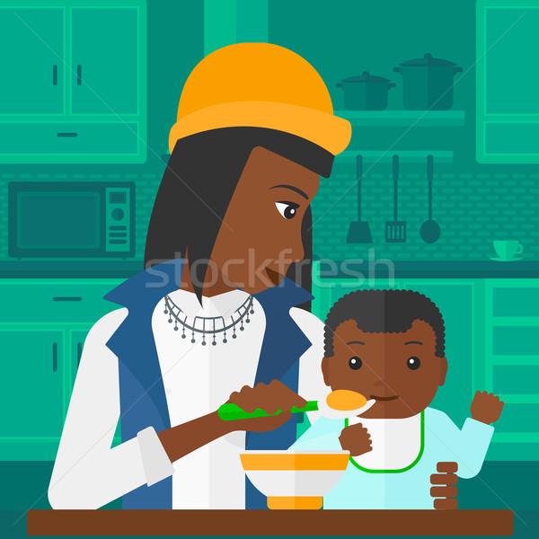 Woman feeding baby. Stock photo © RAStudio