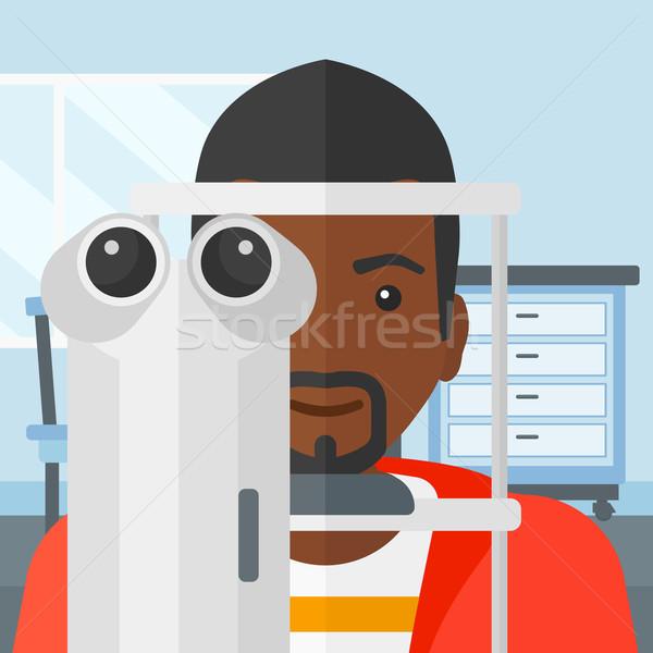 Patient homme examen de la vue médicaux bureau Photo stock © RAStudio