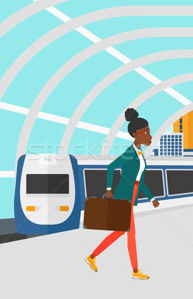 Woman going out of train. Stock photo © RAStudio