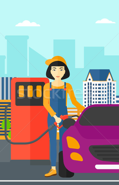 Woman filling up fuel into car. Stock photo © RAStudio