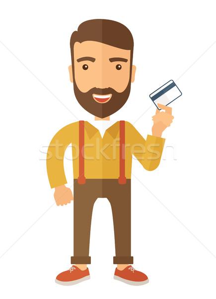 Business man holding credit card Stock photo © RAStudio
