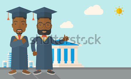 Two men wearing graduation cap. Stock photo © RAStudio