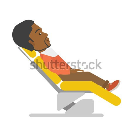 Man lying in dentist chair. Stock photo © RAStudio