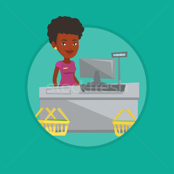 Cashier standing at the checkout in supermarket. Stock photo © RAStudio