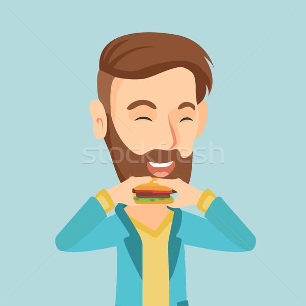 Hombre comer hamburguesa caucásico alegre feliz Foto stock © RAStudio