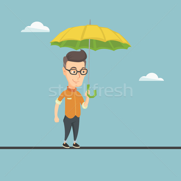 Business man balancing on a tightrope. Stock photo © RAStudio