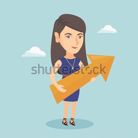 Businesswoman aiming at business growth. Stock photo © RAStudio
