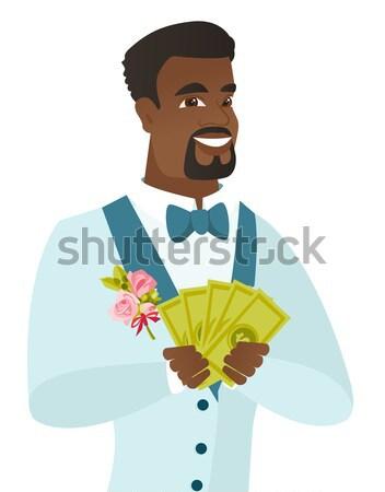 Young african-american groom giving thumb up. Stock photo © RAStudio