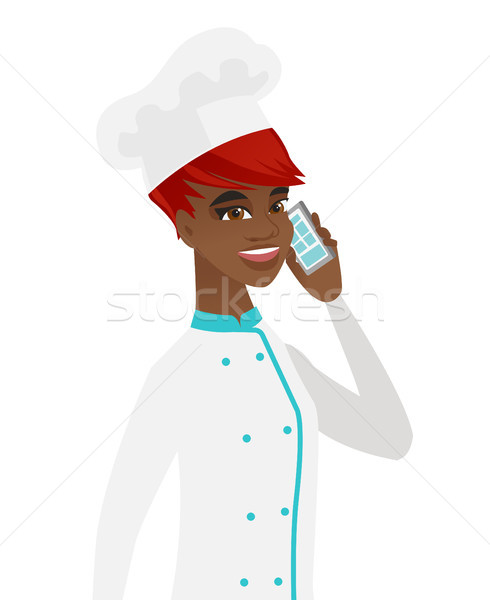 African-american chef talking on a mobile phone. Stock photo © RAStudio